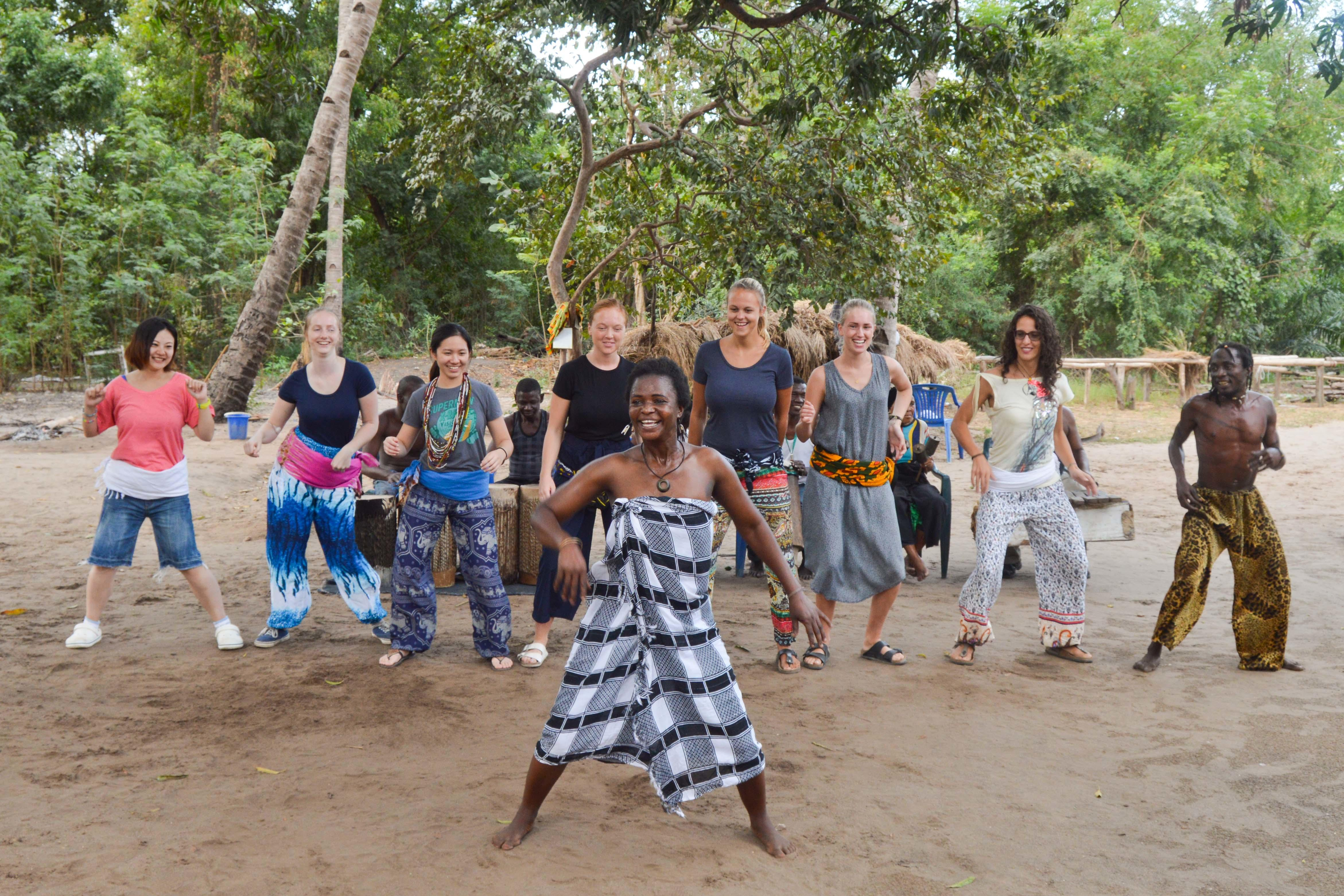 Volunteers learn about local culture during volunteer work in Tanzania for teenagers